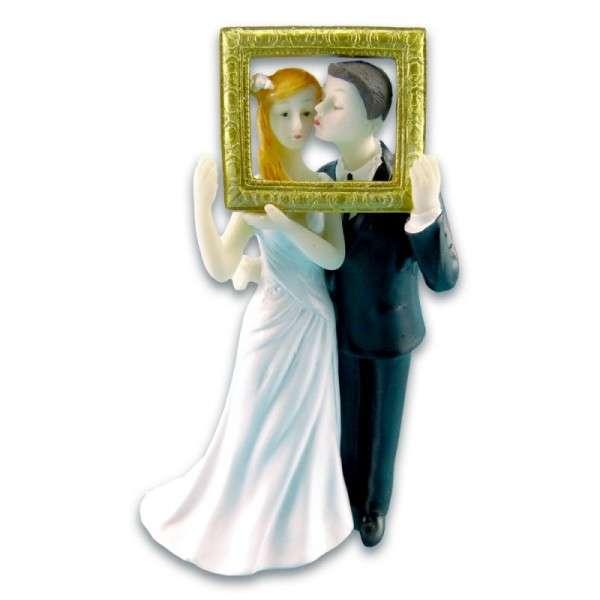 Brautpaar mit Bilderrahmen